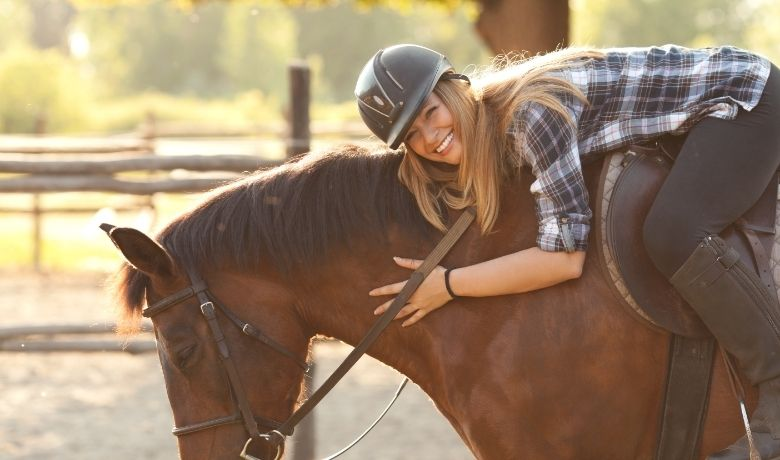 women with horse riding hat